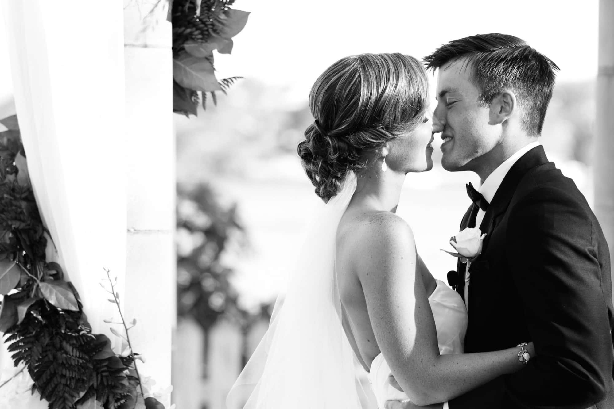 first kiss bride groom photo